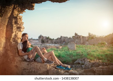 Embracing couple on the ancient Greek ruins background. Manavgat, Turkey