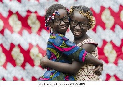 Embracing Friends - Beautiful African Girls Smiling together