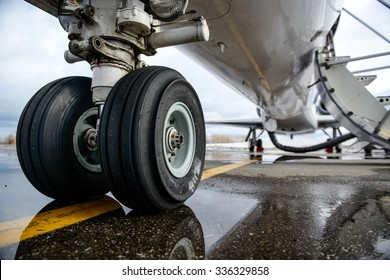 Embraer ERJ 145 aircraft landing gear on the runway