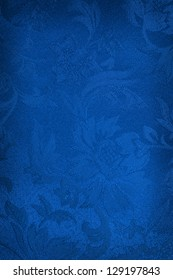 Embroidered blue silk or damask background.