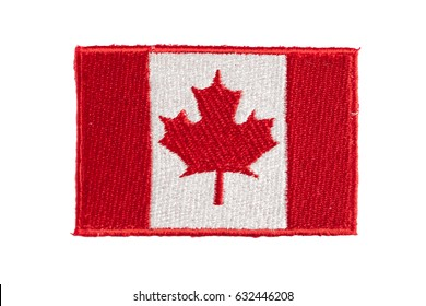 An embroidered Canadian flag patch isolated on a white background. These patches can typically be found on the shoulders of military or police uniforms or on the backpacks of travelers.
