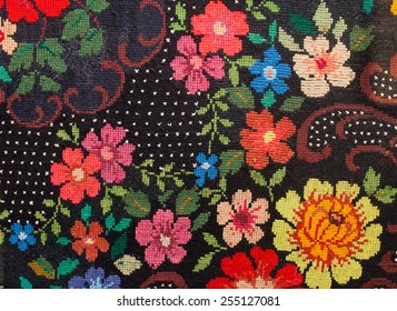 embroidered cross-stitch flowers on black canvas patterns