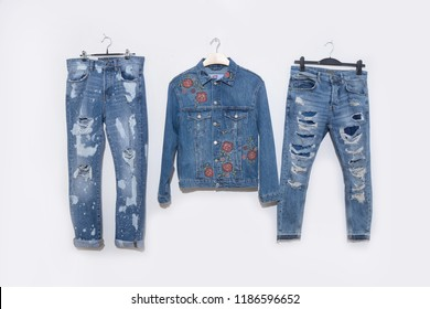 embroidered floral jacket with two blue jeans isolated