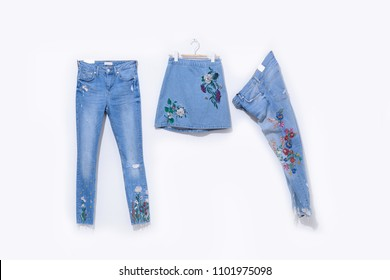 embroidered floral skirt with floral jeans isolated