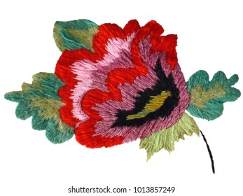 Embroidered flower of a Poppy. Ukrainian hand embroidery. Retro style. Isolated.