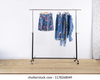 embroidered, flowers, blue jeans with jacket jeans on hanging –white background