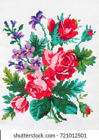 embroidered flowers in a bouquet isolated on a white background, fabric decor, Ukrainian folk handmade cross-stitch