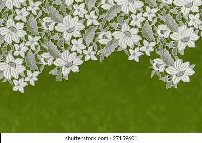 embroidered flowers laid over green velvet paper