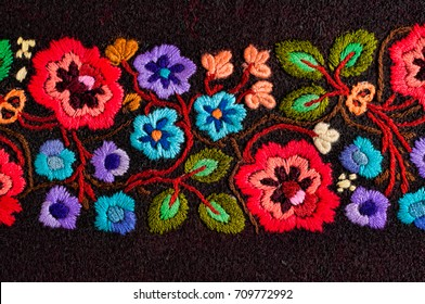 Embroidered handmade colorful flower design.