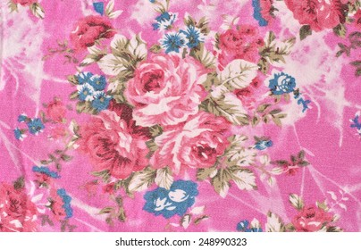 embroidered patterned background with large roses and flowers