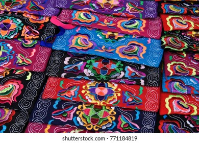 Embroidered textiles for sale along tourist pathway through rice terraces, Longsheng (Longji), Guangxi, China