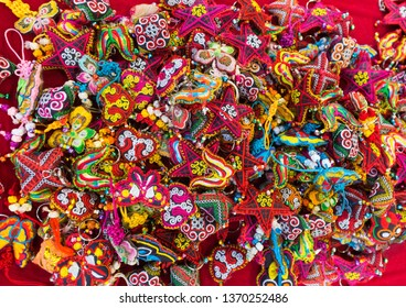 a lot of embroidered trinkets - colorful keychains