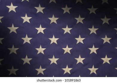 Embroidered white stars on a field of blue which represents the union on the American flag, lit diagonally