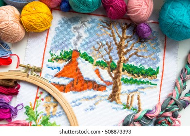 Embroidered winter house with yarn for colour knitting and tambour