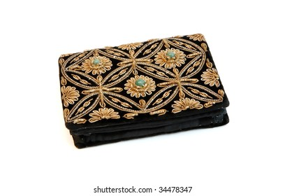 Embroidered woman's purse isolated on white background