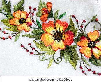 embroidered yellow flowers on white natural fabric, Ukrainian folk embroidery, ornamented clothes