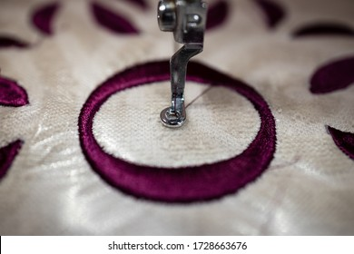 Embroidery design alphabet monogram O on brown fabrics embroidery on machine. Close Up