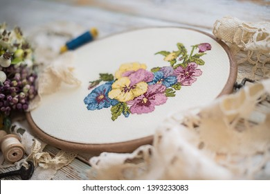embroidery flowers in a frame in vintage style