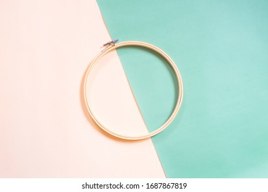 Embroidery hoop on two tone pastel background