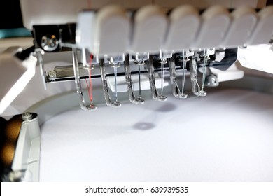 Embroidery machine with blank fabric ready to stitch.