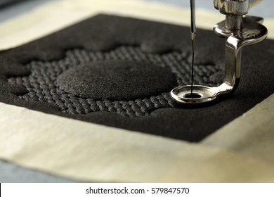 Embroidery with embroidery machine - chain ring - support structure - background and foreground blanked out blurry