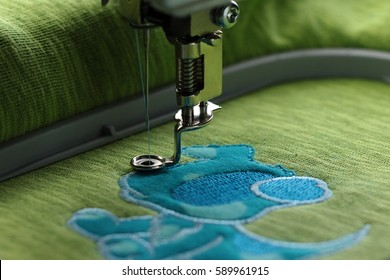 Embroidery with embroidery machine - comic dog application - satin stitch border with visible frame- background and foreground blanked out blurry