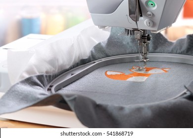 Embroidery with embroidery machine - fox theme - background blanked out blurry
