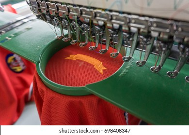 Embroidery machine needle in Textile Industry at Garment Manufacturers, Embroidery t-shirt in progress , Embroidery needle, Needle with thread (selective focus and soft focus)