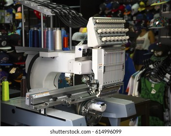 Embroidery machine with spools of color threads