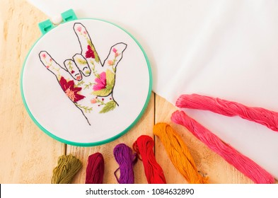 Embroidery on canvas. View from above. Embroidery, as a kind of needlework, creativity and art. Hand embroidery in flowers