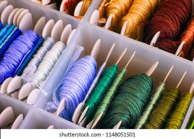Embroidery threads sorting in box. Close-up.