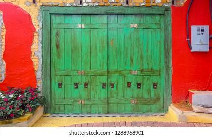 EMBU DAS ARTES, BRAZIL - 26 Dezember, 2018: artisanal green door of the Portuguese colonial era in the colonization of Brazil