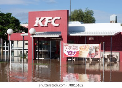EMERALD, AUSTRALIA - JANUARY 1: A KFC Restaurant is surrounded by flood water on January 1, 2011 in Emerald Australia.  The floods would eventually reach the capital city of Brisbane flooding 28,000 homes.
