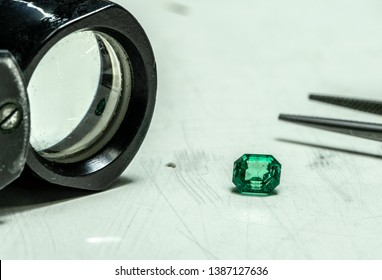 Emerald Gemstone With Jewelry Loupe and Tweezers