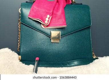 Emerald Green Bag With Pink Gloves and Lipstick