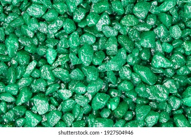 Emerald green gemstone pattern. Glitter semiprecious stones for decoration, flat lay, top view background.
