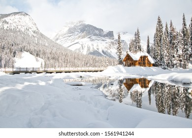 Emerald lake, BC, Canada- Jan. 23, 2019: Emerald lake and  lodge covered with snow in winter and the atmosphere is quite peaceful.  The reflection of the Emerald lodge in the river is spectacular.