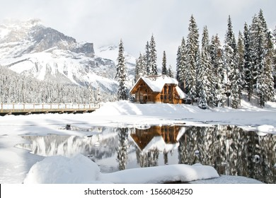 Emerald lake, BC, Canada- January 23, 2019: The Emerald lake and lodge covered with snow in winter and the atmosphere is quite peaceful. The reflection of the Emerald lodge in the river is spectacular