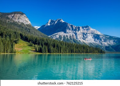 Emerald Lake is ringed by forest and silhouetted by impressive mountains, including the iconic profile of Mt Burgess to the southeast - Emerald Lake, Yoho National Park, Canada