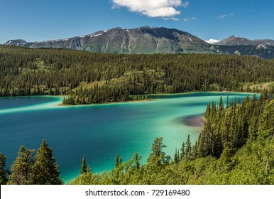 Emerald Lake - This is a shot of Emerald Lake in the Yukon Territory in Canada. It is near the town of CarCross.  Emerald lake is a glacier lake as show by the teal coloring of the water.