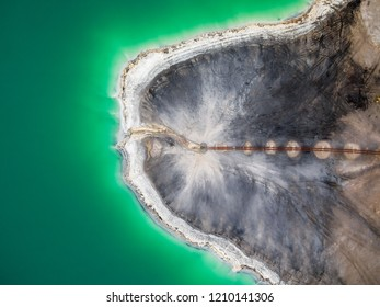 Emerald lake top view, abstract fantasy green and brown pattern background