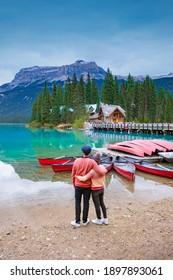 Emerald Lake, Yoho National Park in Canada, Emerald Lake and Tea House, Near Field, British Columbia, Yoho National Park, Canada Mount Burgess can be seen reflected into the water. couple kayak lake