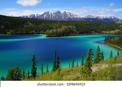 Emerald Lake, Yukon, Canada with mountains and forest on the background.