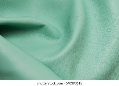 Emerald leather texture background. Emerald leather texture closeup background.