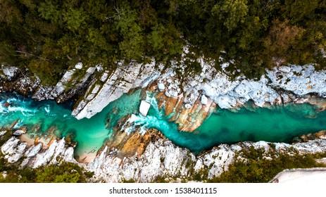 Emerald Soca River in Soca Valley, Slovenia. Aerial Drone Top Down view.