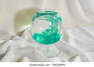 Emerald watercolor in a glass. Color mix in the glass.