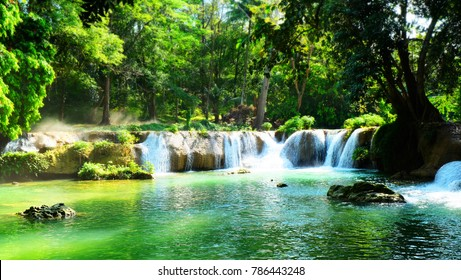 Emerald waterfall in public park for relaxing time.