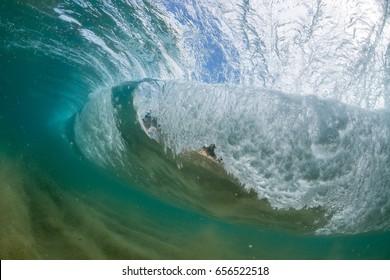 emerald Wave breaking in tropical island waters
