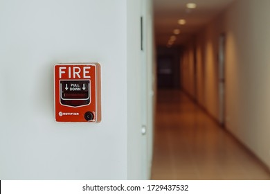 Emergency alarm button installed in a residential building