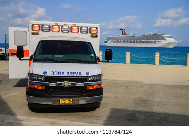 Emergency ambulance at port of Grand Cayman island and a ship of Carnival cuise lines at the back. July 8, 2018